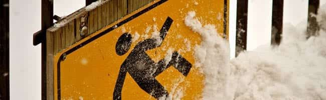 Street Sign Submerged in Snow